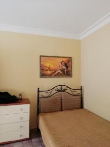 Кровать или кровати в номере Apartamienty Gorkogho 38