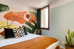 A bed or beds in a room at Selina Secret Garden Lisbon