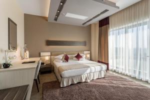 מיטה או מיטות בחדר ב-New Splendid Hotel & Spa - Adults Only (+16)