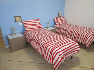 A bed or beds in a room at B&B Relax