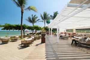 A restaurant or other place to eat at Fairmont Sanur Beach Bali Suites & Villa