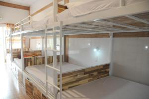 A bunk bed or bunk beds in a room at Hoang Nga Guesthouse
