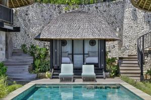 The swimming pool at or near Suarga Padang Padang