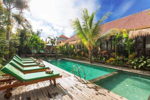 The swimming pool at or near Meruhdani Boutique Hotel Ubud