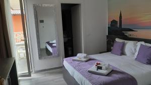 Letto o letti in una camera di Hotel Tre Rose