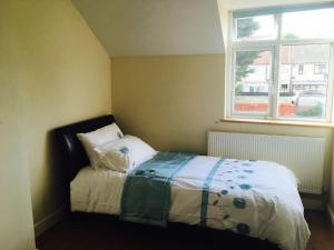 A bed or beds in a room at Comfort Villa London