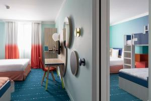 A bed or beds in a room at Magic Circus Hotel Marne La vallee