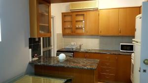 A kitchen or kitchenette at Paradise Gardens
