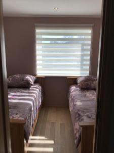 Voodi või voodid majutusasutuse Aisa 21 Apartment toas