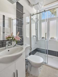 Koupelna v ubytování Apart House Plesia2