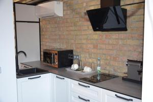 A kitchen or kitchenette at StanGret Hotel