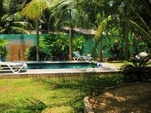 The swimming pool at or near Woodland Villa