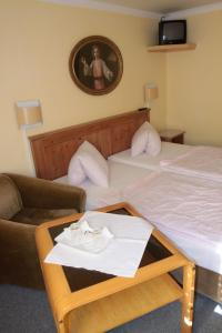 A bed or beds in a room at Penzion Nikola