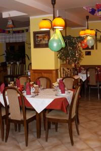 A restaurant or other place to eat at Penzion Nikola