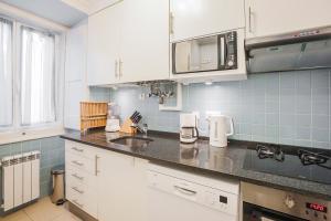 A kitchen or kitchenette at LV Premier Apartments Baixa- PR