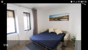 A bed or beds in a room at 13 Calle San Jacinto