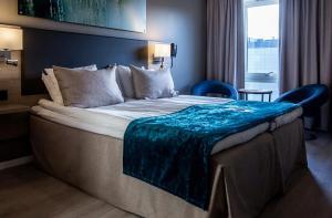 En eller flere senger på et rom på Strömstad Spa & Resort