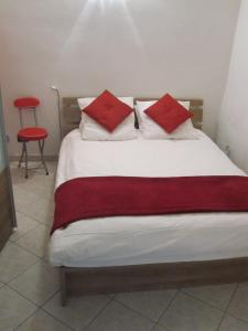 A bed or beds in a room at Studio Vieux Menton