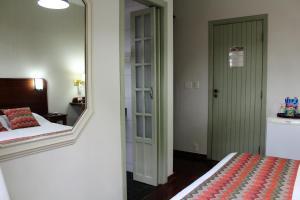 Cama ou camas em um quarto em Pousada O Garimpo