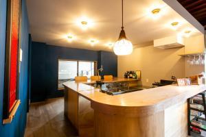 Guesthouse OYADO SAPPORO にあるキッチンまたは簡易キッチン