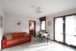 Area soggiorno di Strale Family Apartment