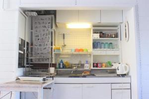 A kitchen or kitchenette at Yado Retro House Ginza Asahikawa