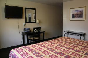 A television and/or entertainment center at Lava Spa Motel & RV