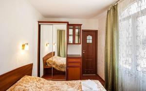 A bed or beds in a room at Guest House Y Viktorii