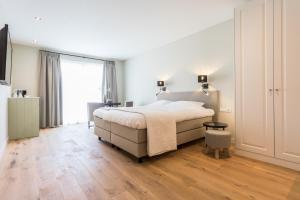 Een bed of bedden in een kamer bij NaarZeeland