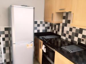 A kitchen or kitchenette at Bexleyheath Town Centre House