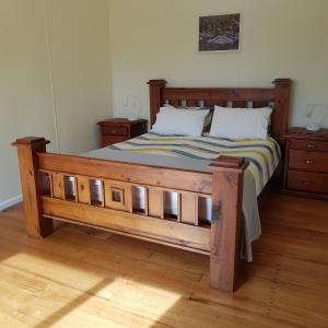 A bed or beds in a room at The Nook Gembrook