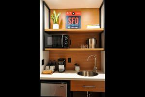A kitchen or kitchenette at Infinity Hotel SF, Ascend Hotel Collection