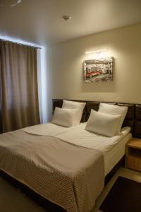 Кровать или кровати в номере Отель Квартал