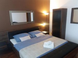 Ein Bett oder Betten in einem Zimmer der Unterkunft Apartman Praha