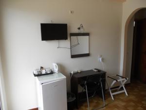 Телевизор и/или развлекательный центр в Hotel Milton