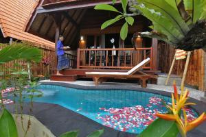 The swimming pool at or near Yoki's Bungalow