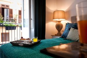 A bed or beds in a room at Palazzo Natoli Boutique Hotel