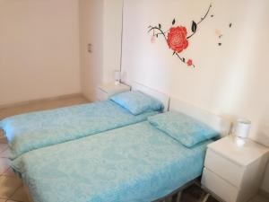 A bed or beds in a room at Vile Park Apartments
