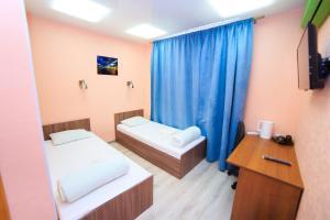 Кровать или кровати в номере Hotel DoBro
