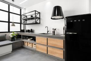 A kitchen or kitchenette at La Maison Athenes