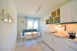 Kuchnia lub aneks kuchenny w obiekcie Apartament Sjesta Park