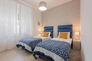 A bed or beds in a room at S. Martino Rooms