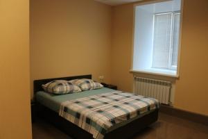 Кровать или кровати в номере Мотель на Карельской