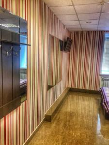 Телевизор и/или развлекательный центр в Мотель на Карельской