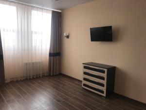 Телевизор и/или развлекательный центр в Мотель Руслан