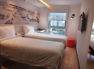 Cama ou camas em um quarto em ibis Styles Montevideo