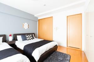 Una cama o camas en una habitación de Karasuma Annex / Vacation STAY 3885