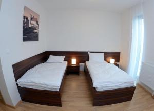 Posteľ alebo postele v izbe v ubytovaní Hotel Bélier