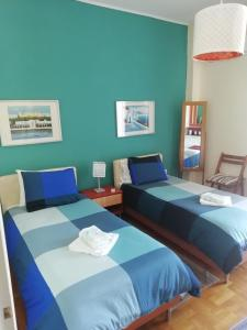 A bed or beds in a room at Elpidos Park