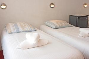Cama ou camas em um quarto em Hotel Torenzicht